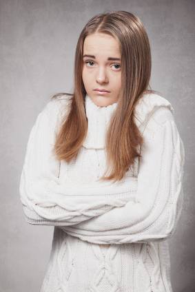beautiful sad girl in a white sweater